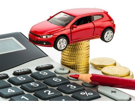 Image That Represents The GST on Cars Concept - Featuring With A Car Kit with calculator, coins and pencil.