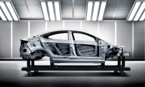 Image Showing A Steel Car In The Manufacturing Stage Placed In An Automotive Enterprise